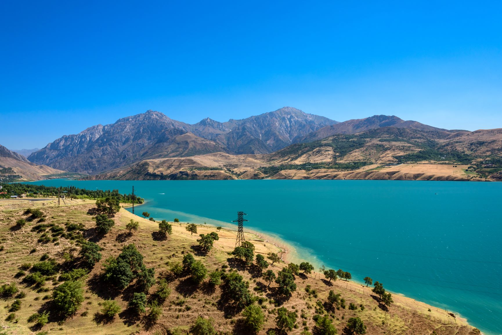 Panoramic view of Lake Charvak, a huge artificial reservoir created by erecting a stone dam on the Chirchiq River - 