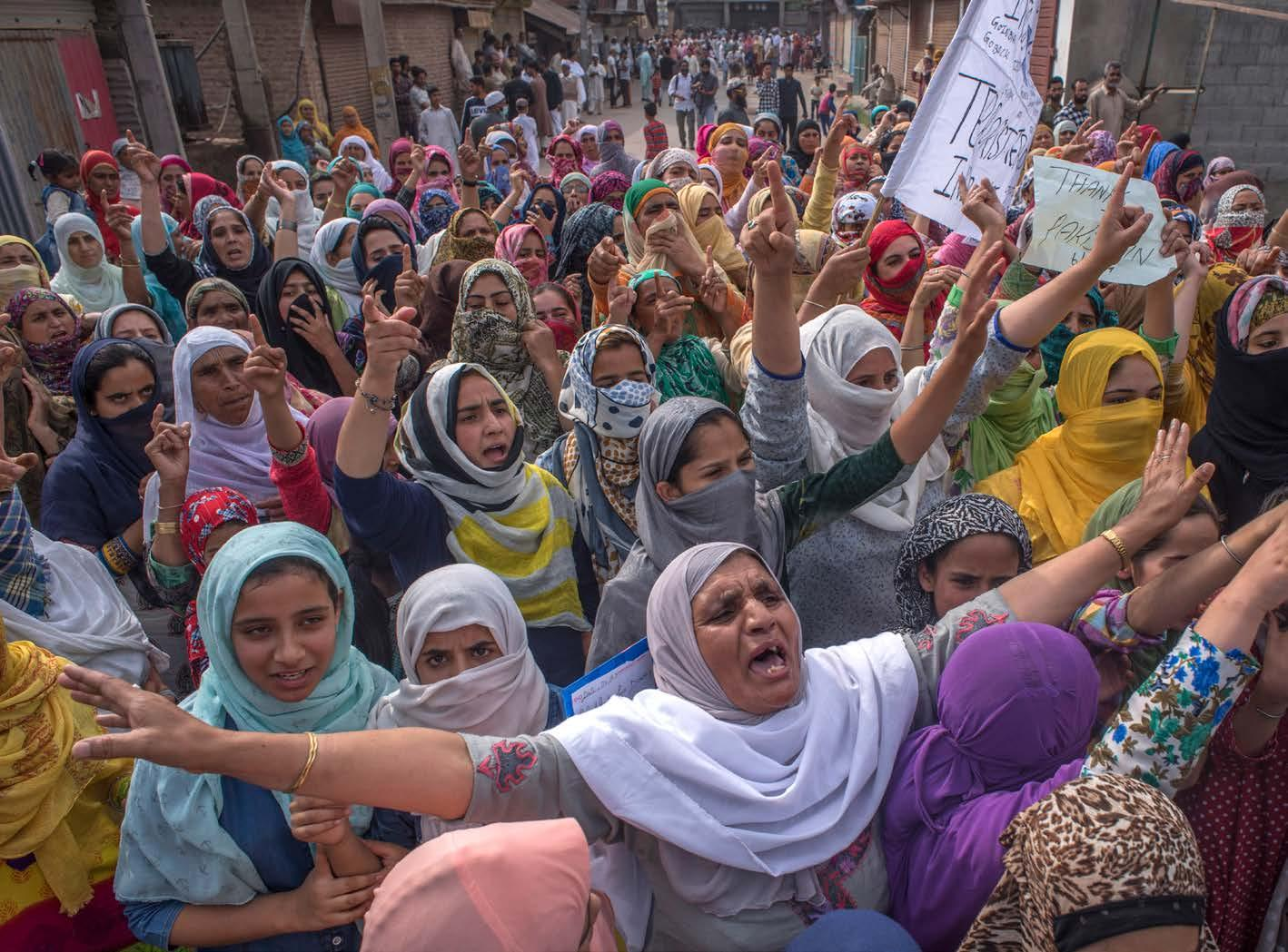 Muslim women protest against India's revocation of the special status of Jammu and Kashmir.