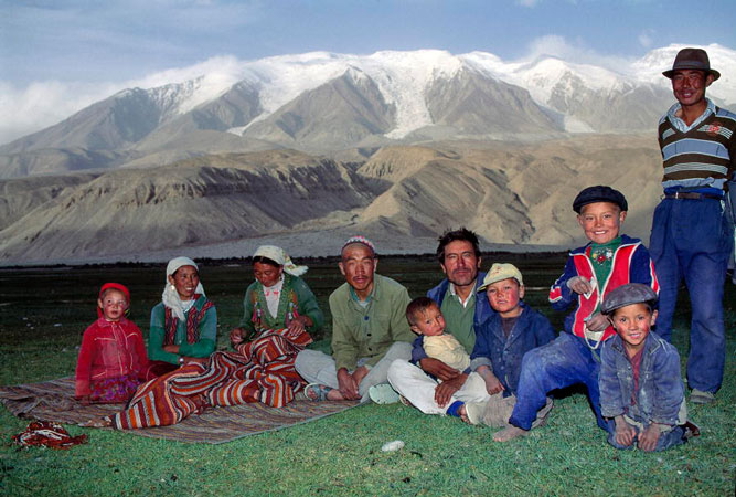 A Kirghiz family at the foot of the Kongur mountains in Xinjiang, China.