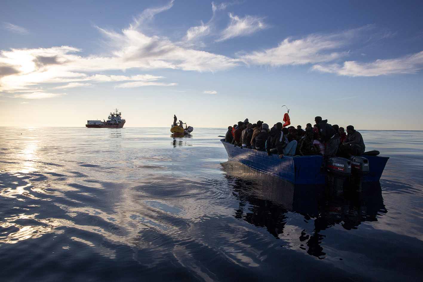 Immigrants arriving in Europe from the coast of Libya in a dangerously overcrowded wooden boat.
