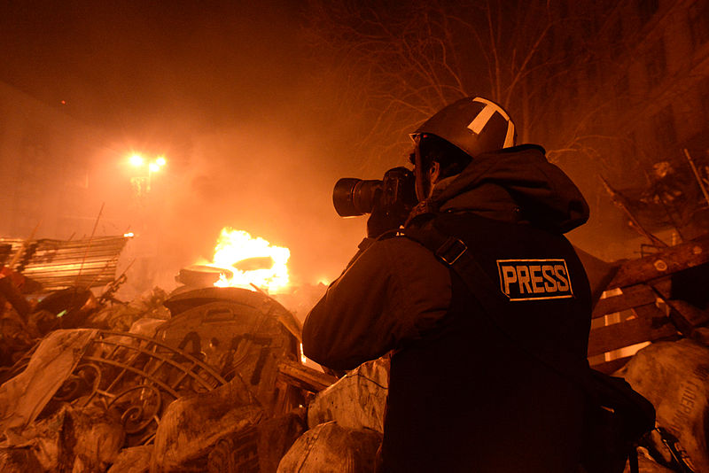 Journalist documenting events at the Independence square during the clashes in Ukraine, Kyiv, 18 February, 2014.