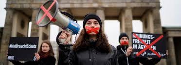 """Immagine di copertina del rapporto di Amnesty International  """"Obiettivo: silenzio. La repressione globale contro le organizzazioni della società civile"""""""