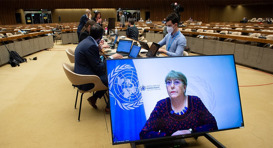 """Michelle Bachelet (on screen), UN High Commissioner for Human Rights, addresses the 30th Special Session of the Human Rights Council on the """"Grave Human Rights Situation in the Occupied Palestinian Territory, including East Jerusalem"""", at Palais des Natio"""
