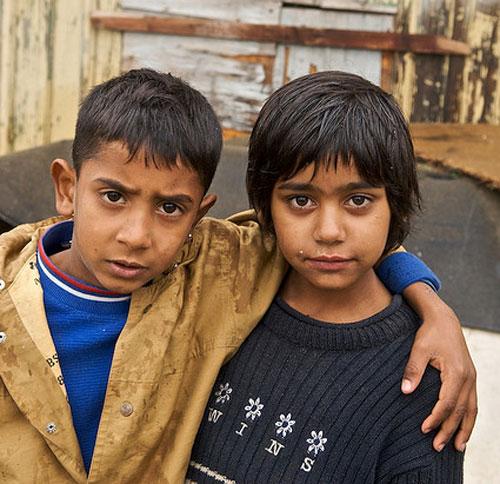"""two Roma children embraced, """"Dosta!"""" campaign, 2007"""
