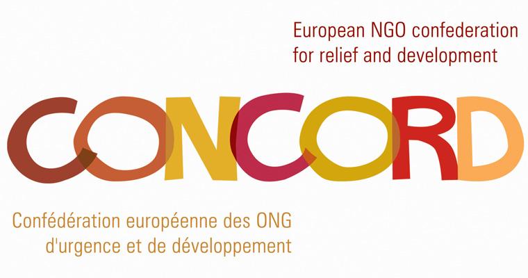 """La scritta """"CONCORD"""", in scala cromatica giallo, arancio e rosso, è affiancata sopra e sotto dalla denominazione ufficiale della confederazione, in francese ed inglese"""