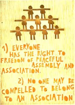 Poster con disegno e testo dell'art. 20 della Dichiarazione universale dei diritti umani.
