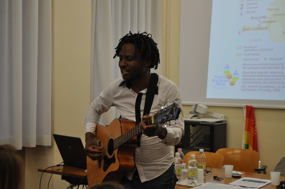 "John Mpaliza is singing ""Hakuna Matata"" at the end of the seminar ""Blood Mobile Phones"", 16 April 2015."