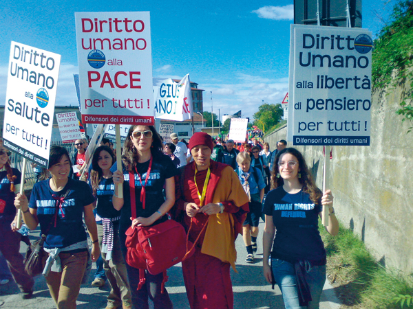 "Students in Human Rights from the University of Padua, at the 'March for Peace Perugia-Assisi' on 7 October 2007. The slogan for the 2007 March for Peace was ""Tutti i diritti umani per tutti"" (All Human Rights for All)."