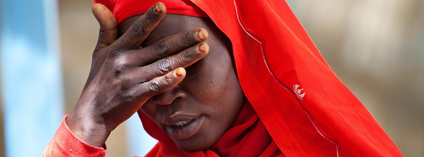 A woman living in Kassab Camp for Internally Displaced People in Kutum, North Darfur, expresses her sorrow over the increase in rapes in the area.