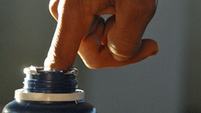 Elections in East Timor: a voter dips his finger in an ink bottle after voting in the election.