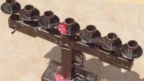 Scultura realizzata con armi di piccolo calibro in laboratori di formazione per fabbri apprendisti e in ambito artistico, dal quale è scaturita l'esposizione 'To Be Deter-mined / At Arms Length' realizzata nell'ambito di un progetto promosso dal Governo della Cambogia in collaborazione con l'Unione Europea (1998).
