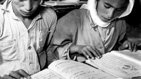 Refugee children attending classes at the Ain-El-Sultan Camp school for boys in the Jordan Valley, Jordan, January 1957.