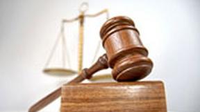 Bilancia e martelletto come simbolo della giustizia