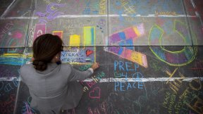 The ground at the UN Visitors' Plaza covered with signatures and drawings for the International Day of Peace.