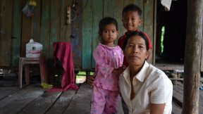 Mother with children in a Cambodian house.