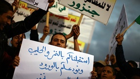 A crowd of demonstrators protest against the atmosphere of lawlessness in Tripoli, 2011