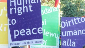 "A group of 50 students and National Civil Service volunteers of the University of Padua carry 28 posters bearing the words: ""Human right to peace"", during the Peace March Perugia-Assisi 2014."