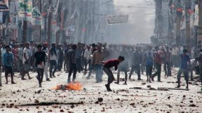 Madhesi protesters throw stones and bricks at Nepalese policemen in Birgunj, a town on the border with India, on Nov. 2, 2015