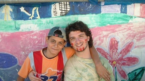 The Italian pacifist Angelo Frammartino with a Palestinian child, 2006