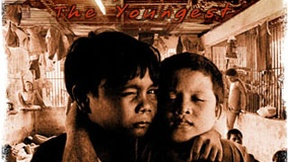 "The image is the film poster of ""Bunso, the youngest"". It shows two grieving children supporting each other inside a jail"