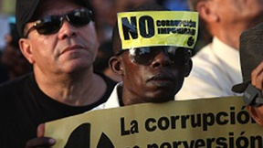 Man during a demonstration against corruption