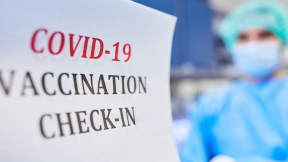 """Banner written: """"covid-19 vaccination check-in"""""""