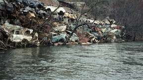 Disused cars piled in a junkyard, an example of environmental damage in the United States. Great Smokey Mountains, North Carolina, taken on 1 January 1975.