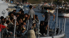 Migrants arriving on the Island of Lampedusa by boat