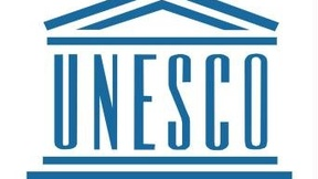 UNESCO is written between two elements: a pitched roof above and a flight of steps below, both typical of a Greek temple, with each letter representing a column of the temple.